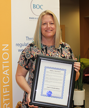 District 8 Director for NATA Carolyn Peters is pictured with the proclamation.