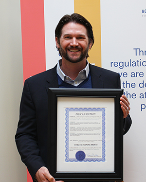 Eric Sauers, who is a member of Commission Leadership for CAATE, is pictured with the proclamation.